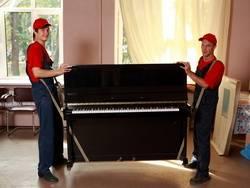 Перевозка пианино с грузчиками недорого.